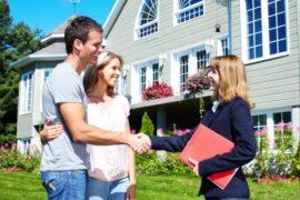 Happy family with agent realtor near new house tenant screening.